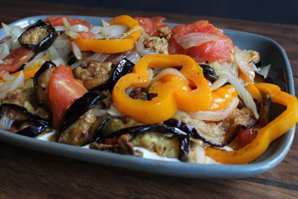 Front view of eggplant dish with peppers on top