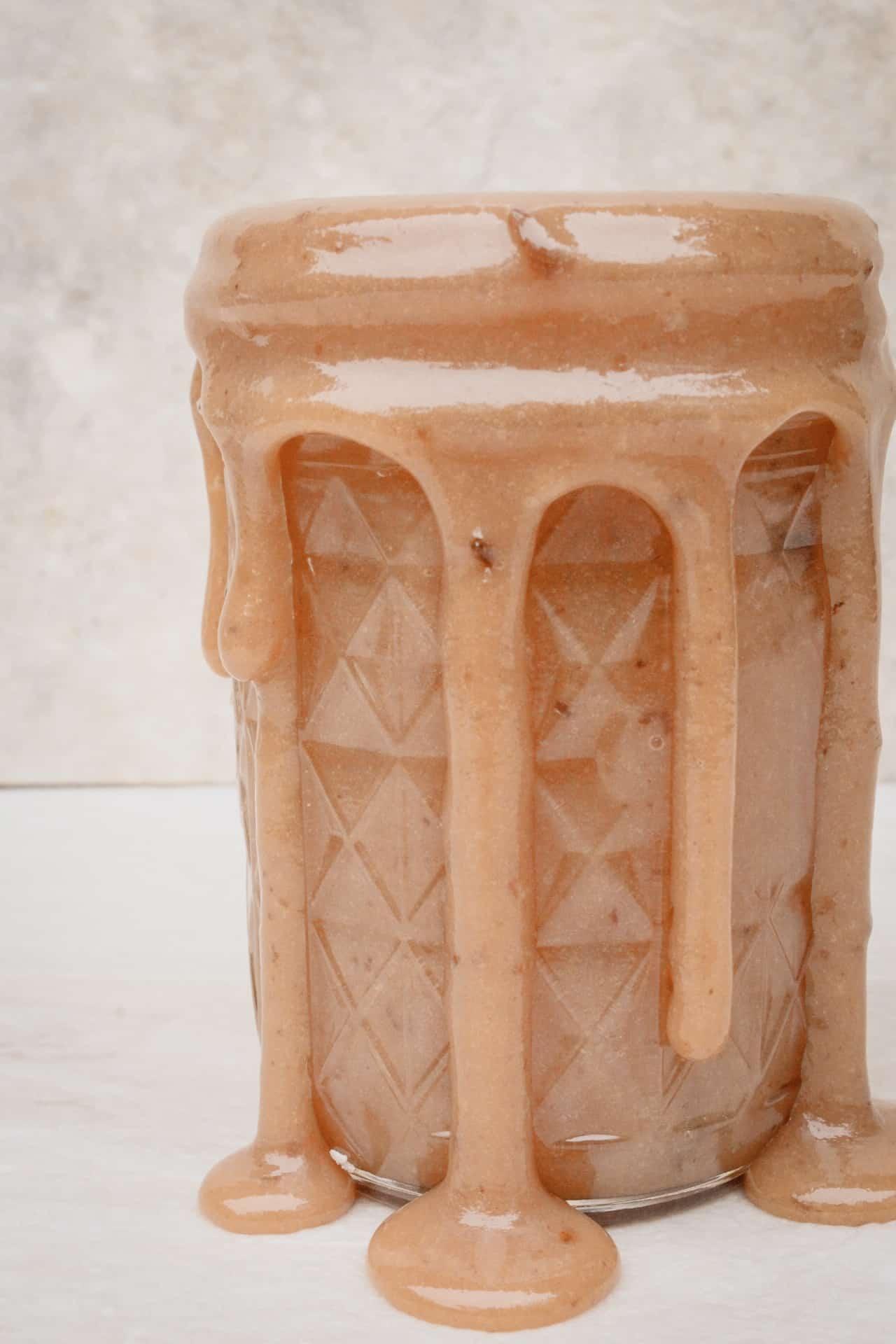 overflowing jar of dulce de leche