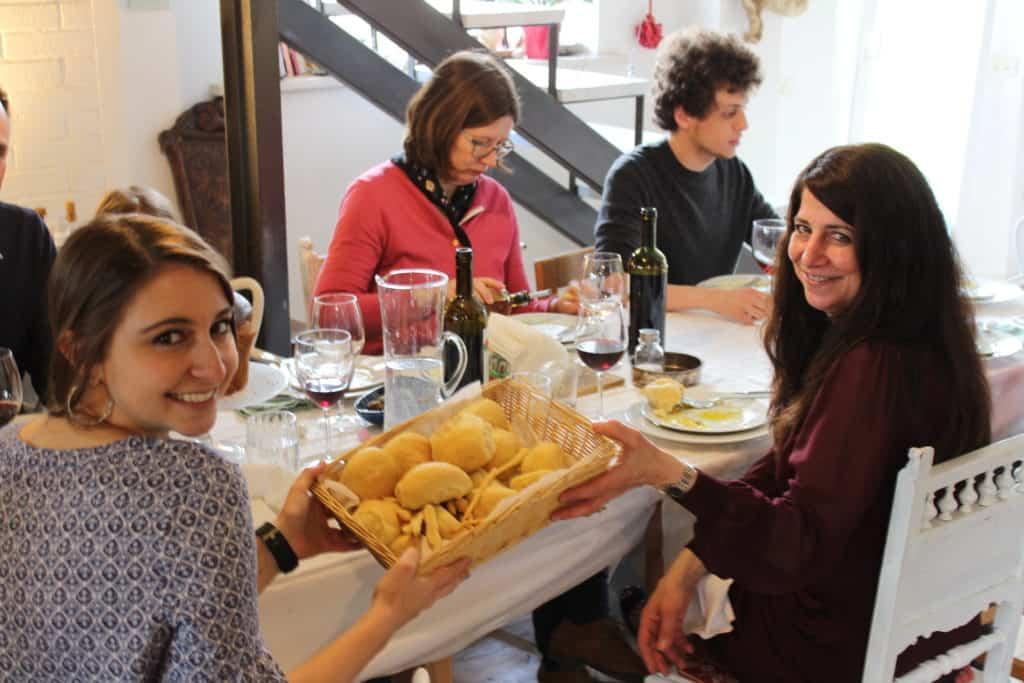 Passing Bread at Claudias Easter Dinner
