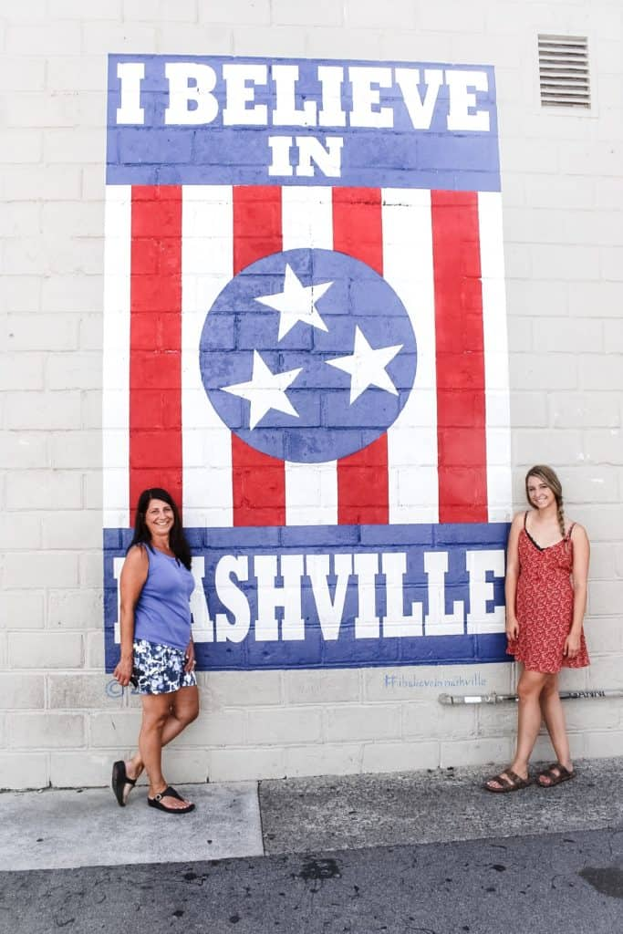Alexandria and her mom in front of the I Believe in Nashville sign