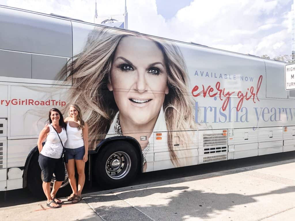 ALexandria and her mom in front of Trisha Yearwood's tour bus