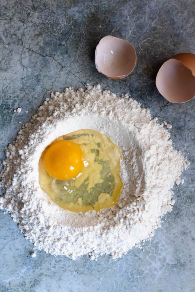 how to make homemade pasta step 2: crack the egg into the well