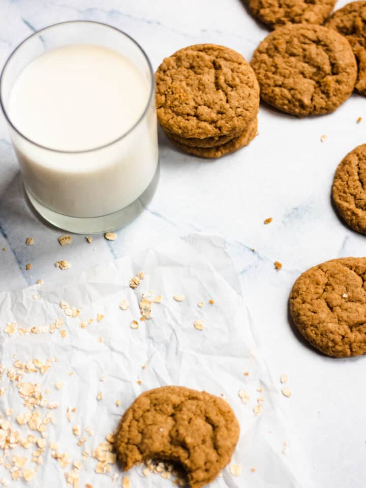 Maple cookies strewn on the table with milk