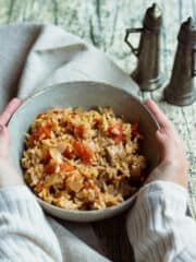 tuna with rice with hands around bowl