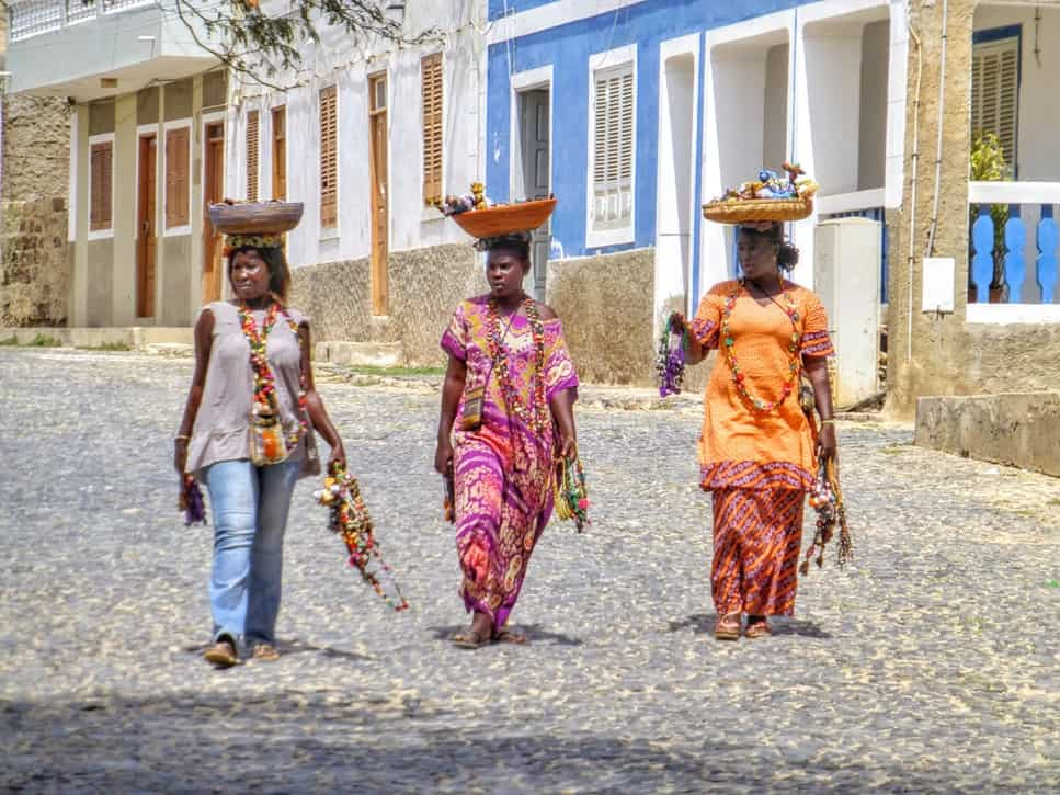 women balancing baskets in cape verde