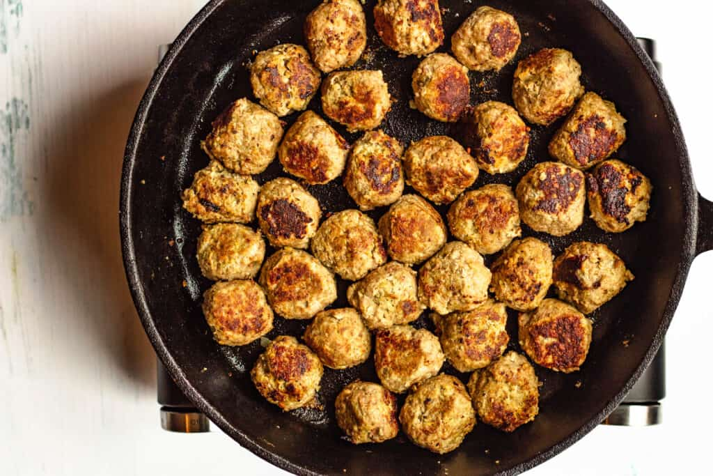 Overhead view of Gluten free meatballs in a cast iron skillet