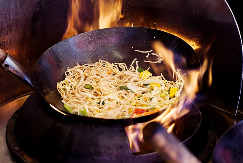 Wok with noodles inside