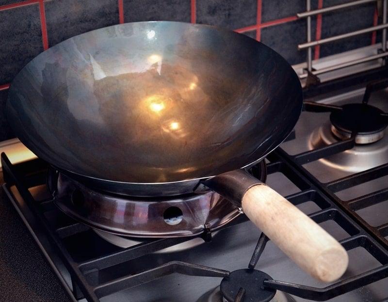 how to season your wok: wok on a flame