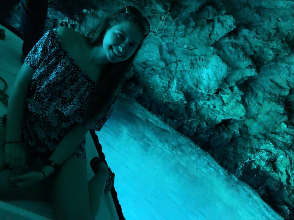 Alexandria on a boat in the blue cave