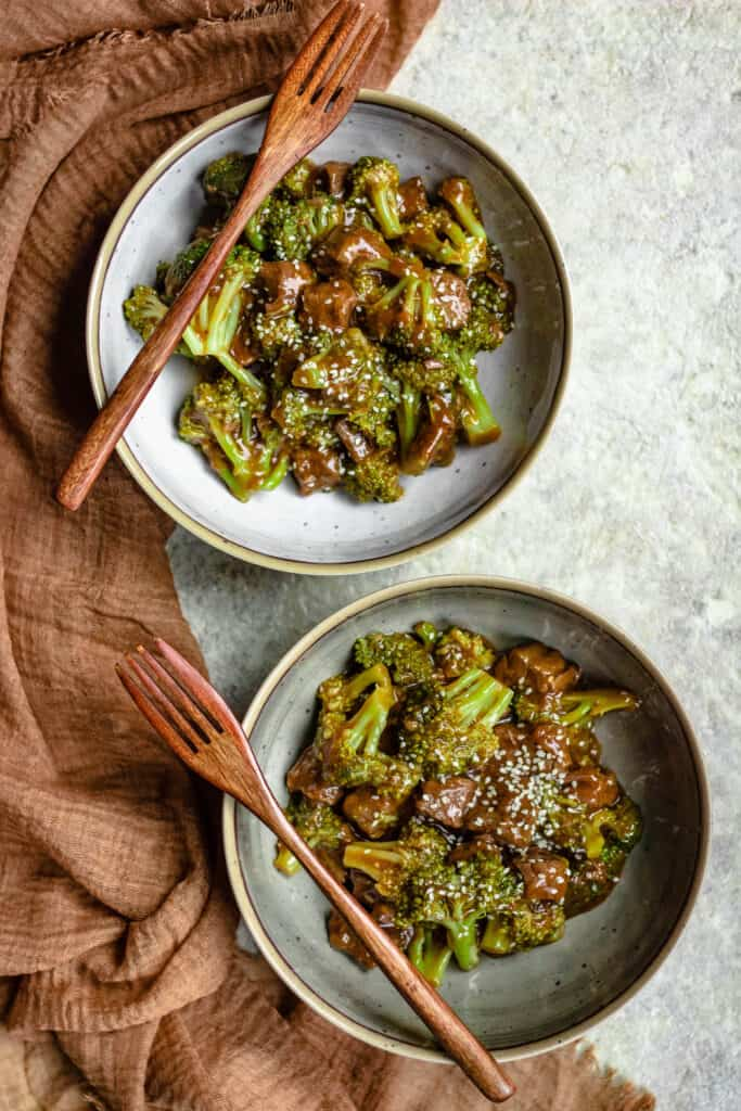 two bowls of instant pot beef and broccoli