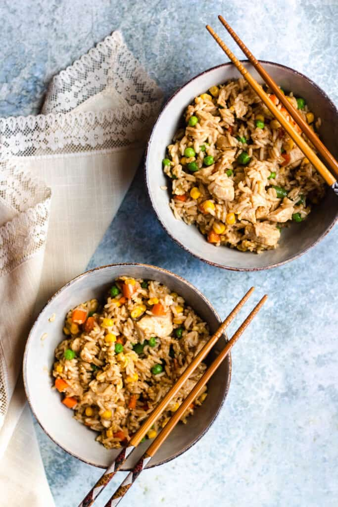 two bowls of Instant Pot chicken fried rice