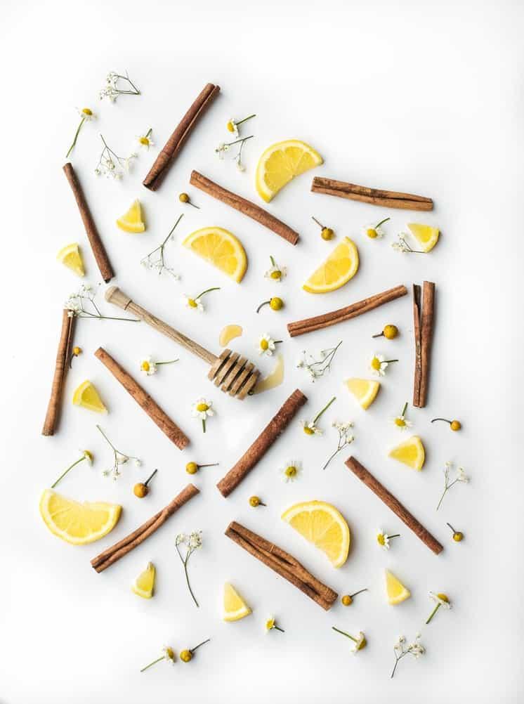 Overhead view of cinnamon sticks and lemon slices