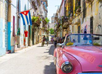 Cuban street with pink car