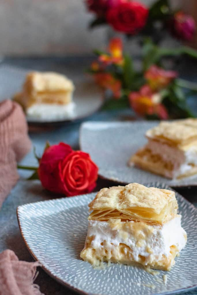 custard cake with roses in the background