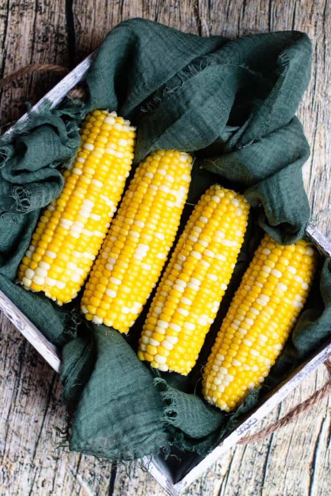 Box full of corn on the cob