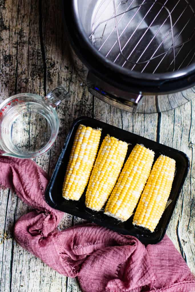 Cobs of corn in front of the Instant Pot