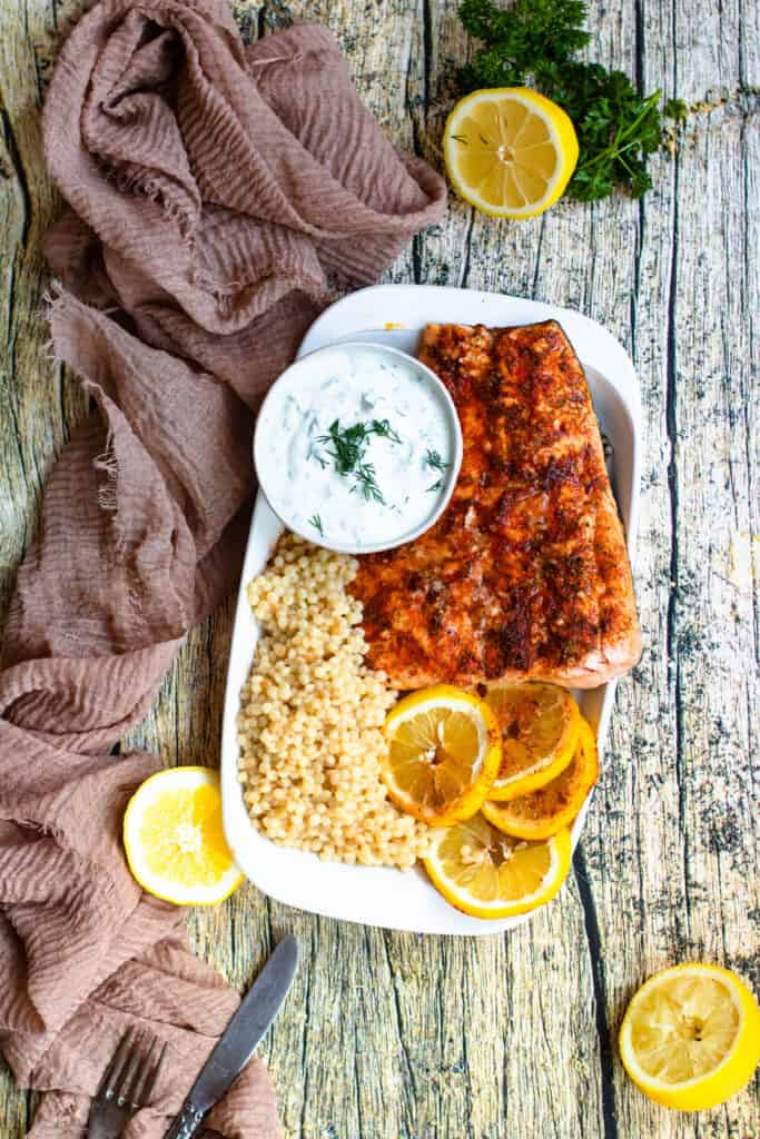 zoomed out salmon with couscous and lemon