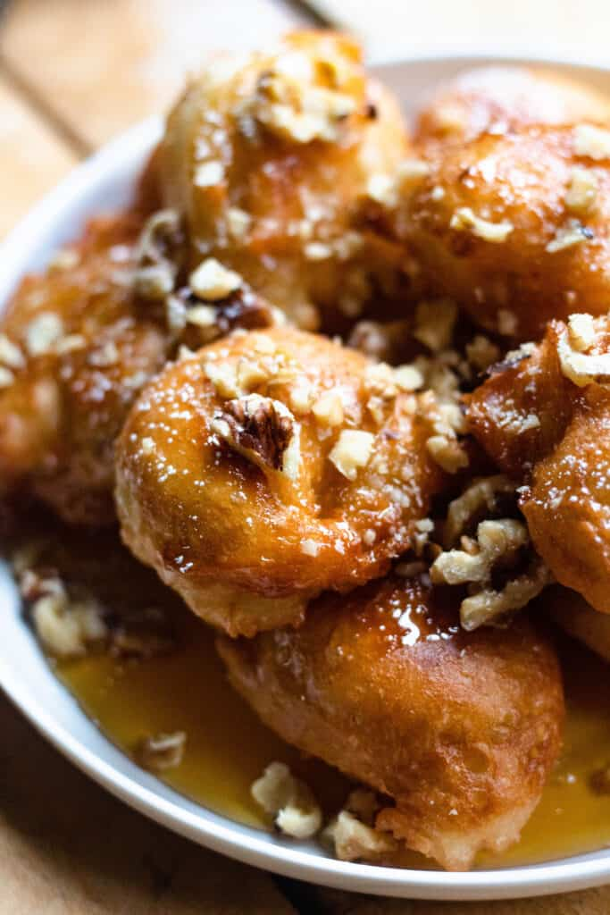 close up of honey donuts with walnuts