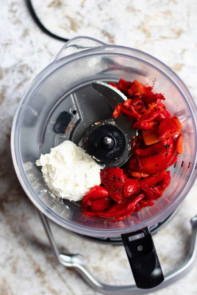 Cream cheese and red peppers in food processor