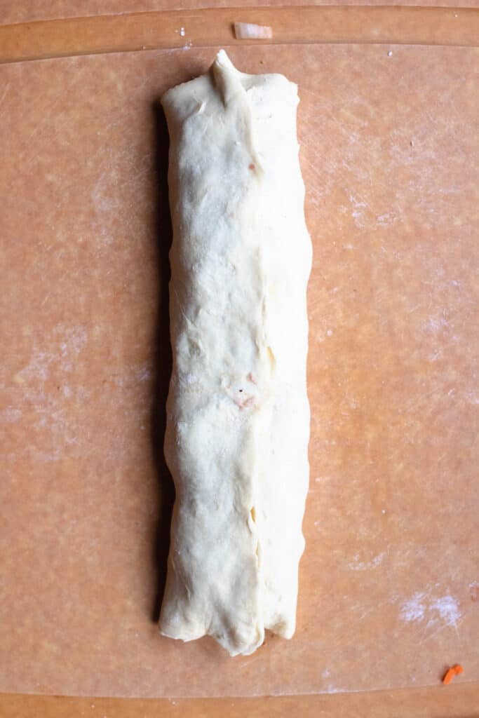 pinched seams of puff pastry roll
