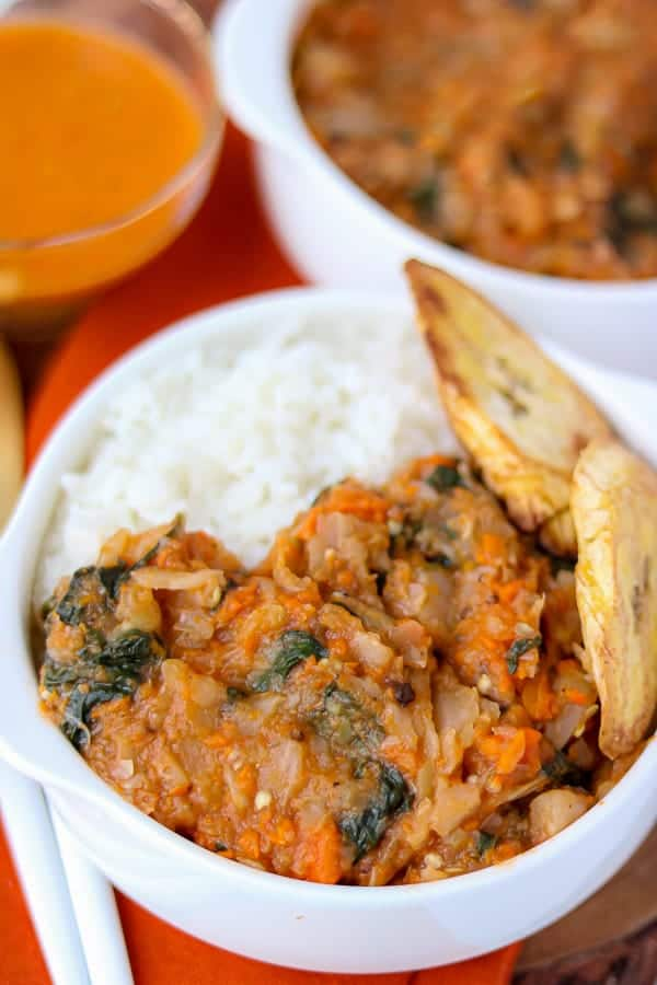 Haitian food: a legume stew with plaints, eggplants, and cabbage