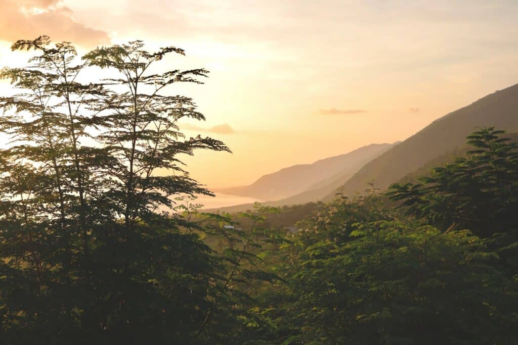sunset in Haiti with rolling hills. This is where much of the wonderful Haitian food comes from.