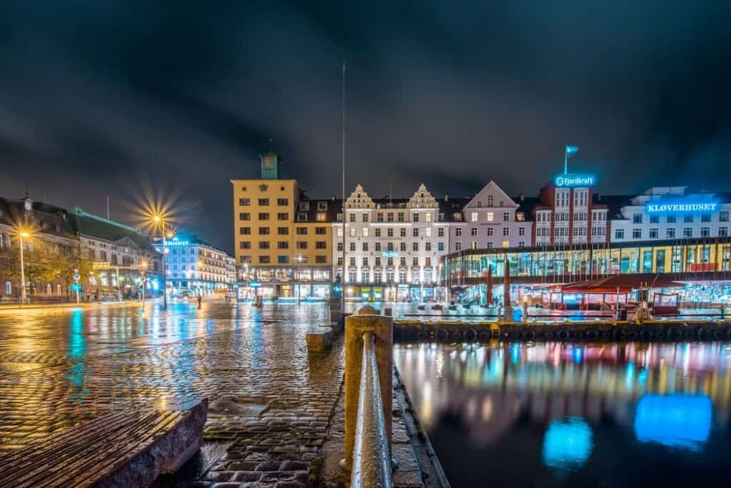 City in Norway with colorful lights and cobblestone walkways