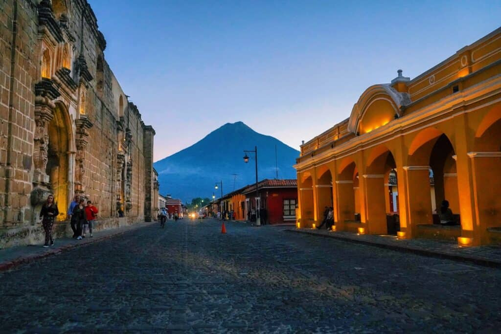 A beautiful street view in Guatemala with a mountain in the background at sunrise
