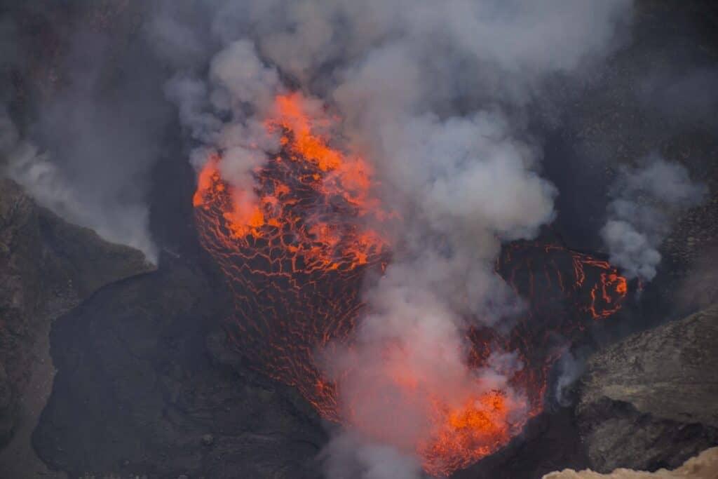 Lava lake with smoke clouds