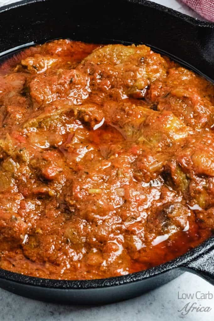 Cast iron skillet filled with Nigerian Beef Stew