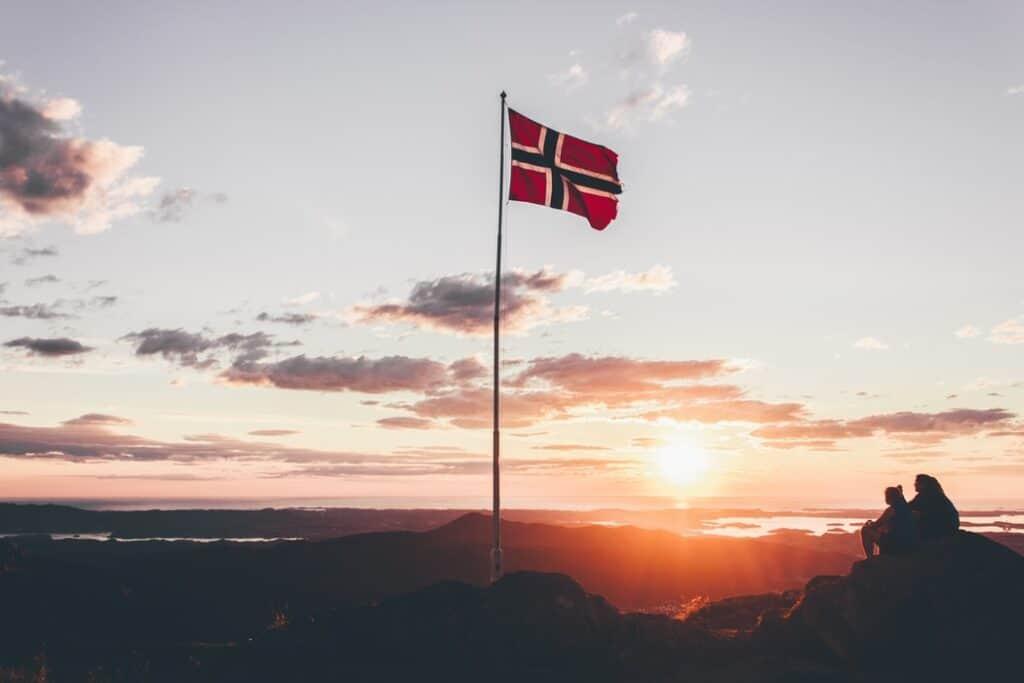 Sunrise over a Norwegian flag
