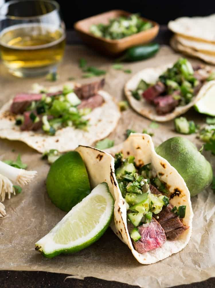 Tacos with limes and meat