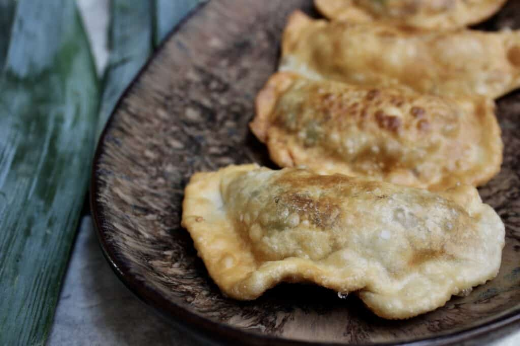 Front view of fried leek pastries