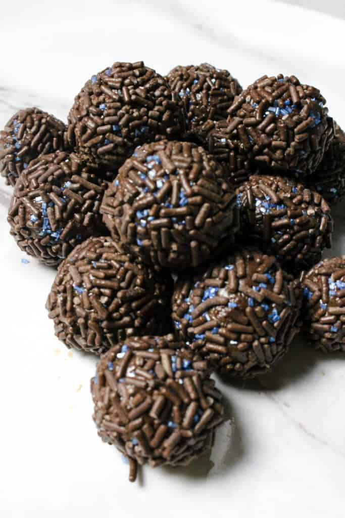 Pile of Brigadeiro with blue and brown sprinkles