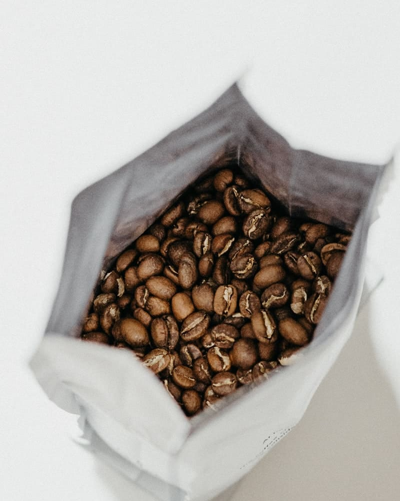 White paper sack full of coffee beans