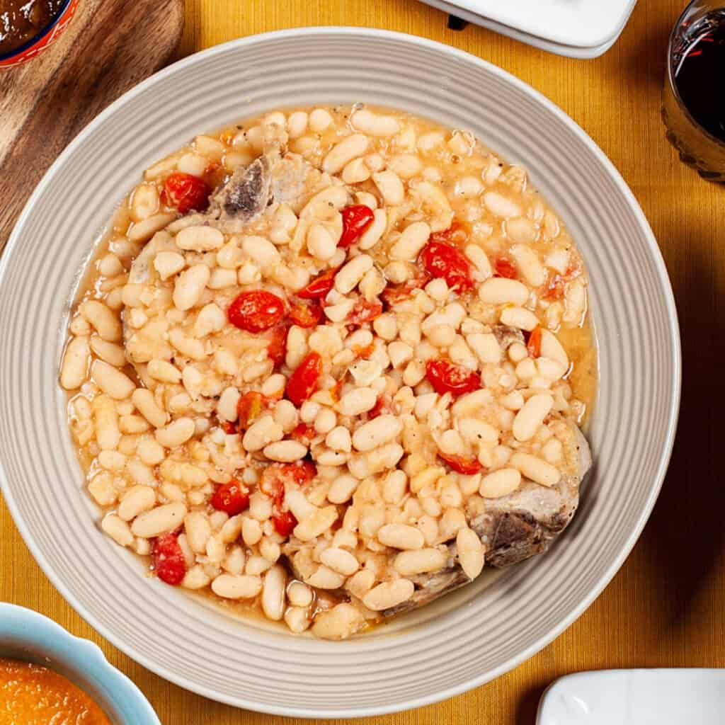 Overhead view of fagioli soup in a white bowl