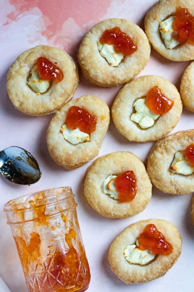 Overhead view of appetizers with goat cheese and papaya jam