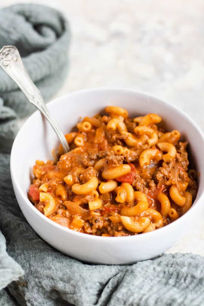bowl of instant pot goulash with green napkin