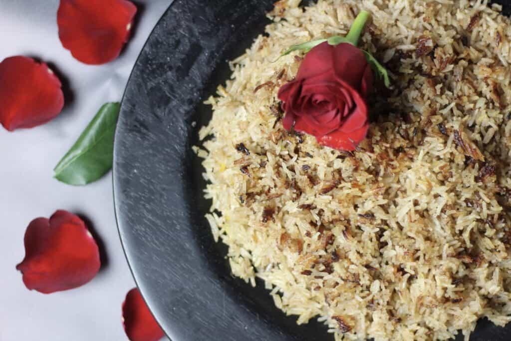 Horizontal view of muhammar sweet rice with rose petals