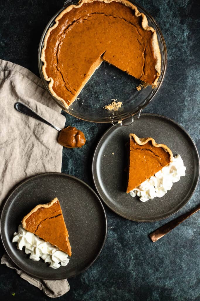 overview of pumpkin pie recipe with slices cut and dulce de leche