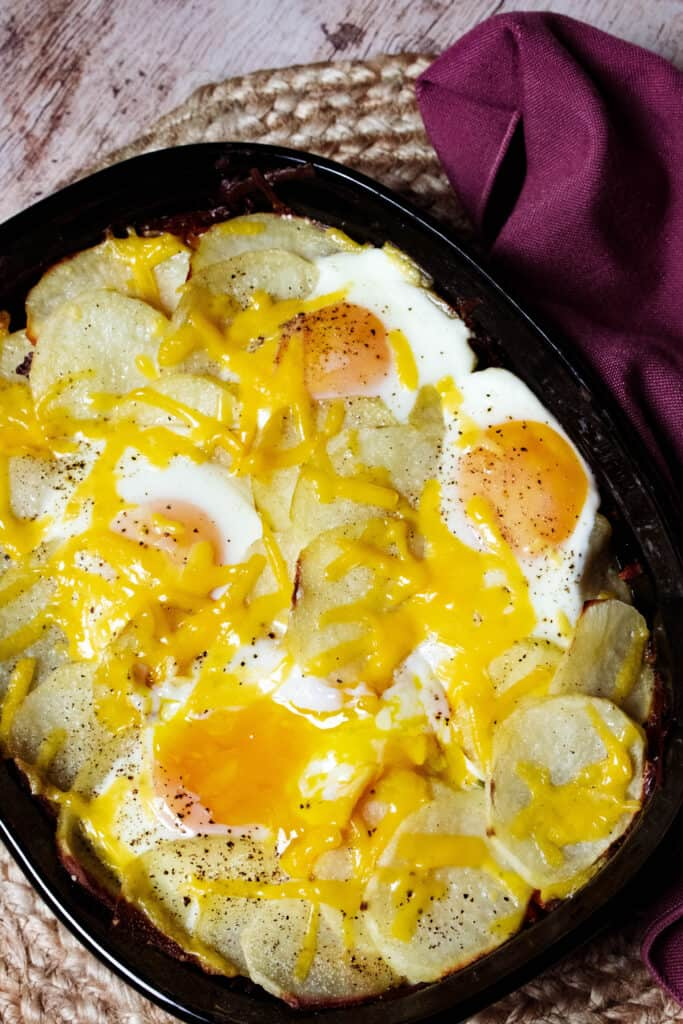 Overhead view of Gyuveche with potatoes, eggs, and cheese