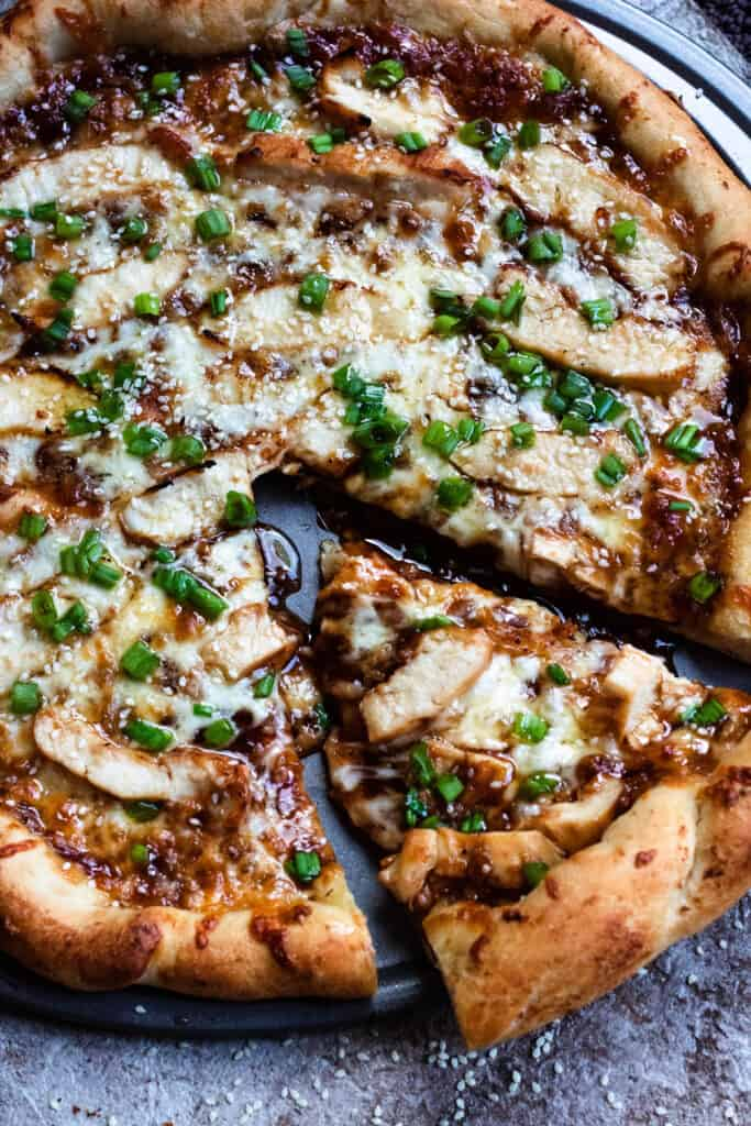 Slice of pizza of honey barbecue chicken pizza