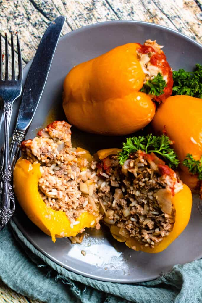 3 Instant Pot stuffed peppers with one cut in half