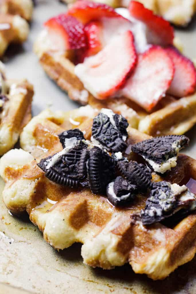 Liege waffles up close decorated with oreos and strawberries
