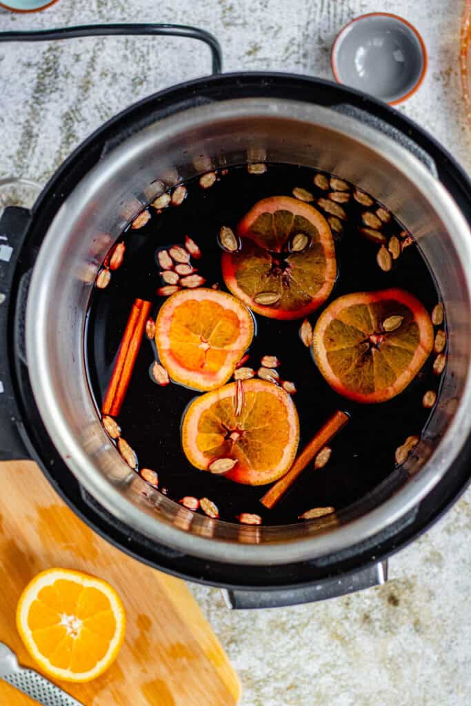 Mulled wine in the Instant pot with floating cardamom and orange slices