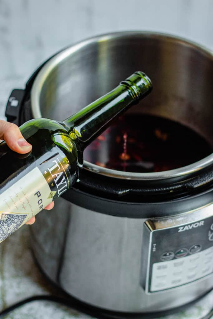 Hand pouring port into Instant Pot