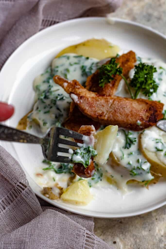 For full of grilled pork belly with potatoes and parsley sauce