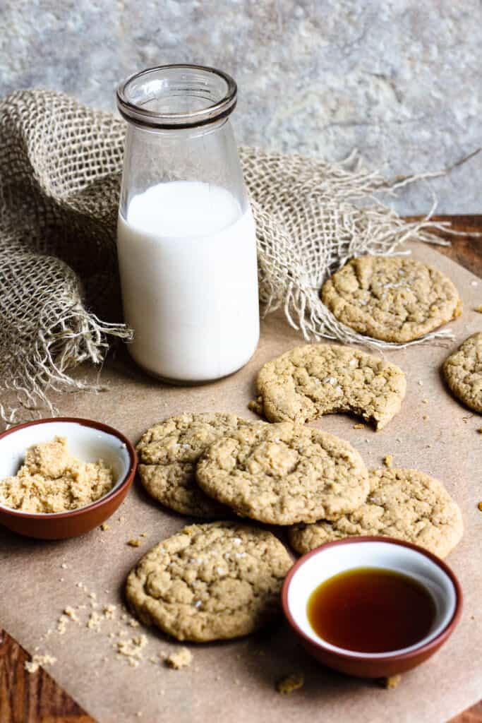 Maple cookies with a jar of milk and maple syrup
