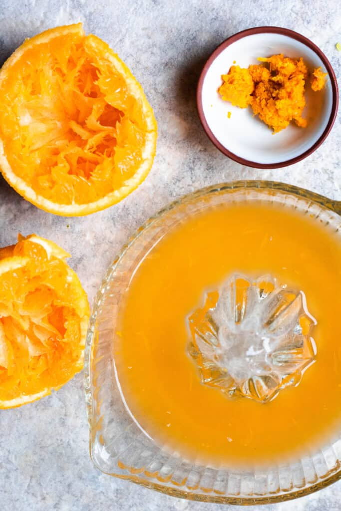 Juiced oranges and orange zest