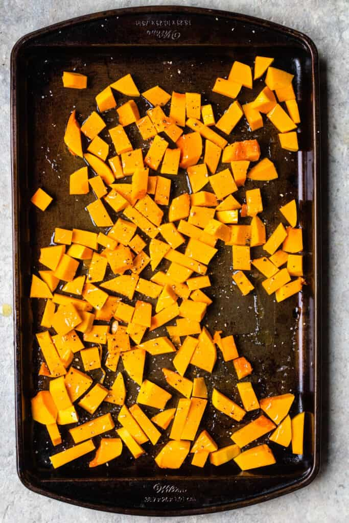 Cookie sheet with cubed butternut squash